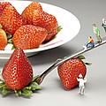 Paul Ge - Lifting strawberry by a...