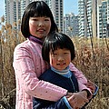 Imran Ahmed - Two Chinese teen sisters...