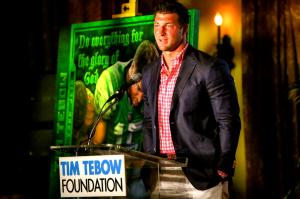 John Prince Original Artwork For The Tim Tebow Celebrity Golf Classic 2013 Starts Bidding Frenzy And Is Auctioned For TWENTY THOUSAND DOLLARS